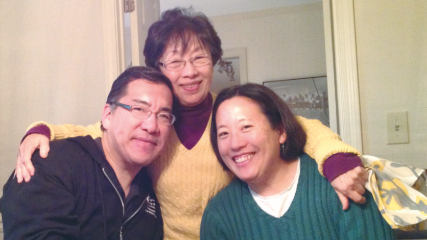 mother father and Young Kim at the kitchen table