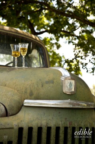 two glasses of cider on an old car