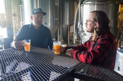 Artist John Riepenhoff talks with Company Brewing owner George Bregar
