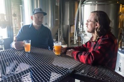 Artist John Riepenhoff talks with Company Brewing owner George Bregar