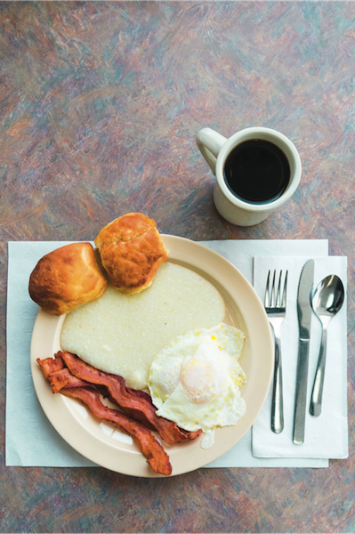 Breakfast of bacon, eggs, biscuits, grits and coffee; Mr. Perkins Family Restaurant